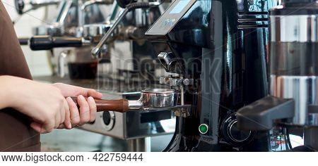 Barista Making Fresh Espresso Coffee. Espresso Machine Portafilters. Closeup