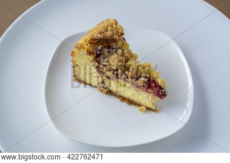 Slice Of Blueberry Cheese Cake On White Plate