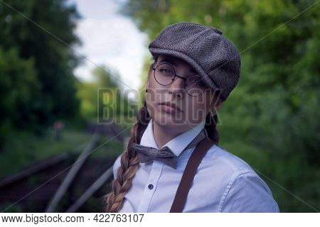 Young Beautiful Girl Dressed In Mens Clothing Of The Twenties. The Style Of The Great Gtsby.