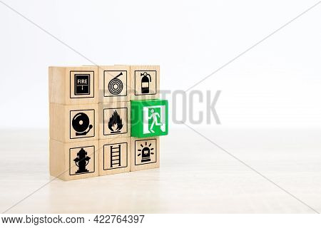 Fire Exit,  Wooden Toy Block Stack With Door Exit Sing Or Fire Escape Icon With Fire Extinguisher An