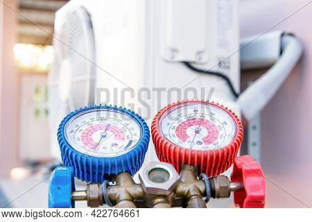 Close-up Manifold Gauge Is Measuring Equipment To Filling Home Air Conditioner And Cleaning Or Check