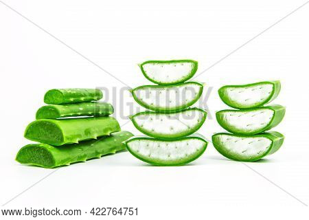 Aloe Vera, Close-up Slices Of Green Fresh Aloe Vera Plant Stacked And Aloe Vera Stalk Or Leaves With