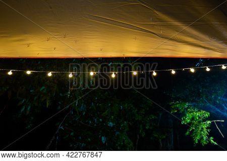 Beautiful Rows Of Bulb Lamps At Camping, Lamp On Dark Background, Yellow Mini Lamp, Tent Lighting.