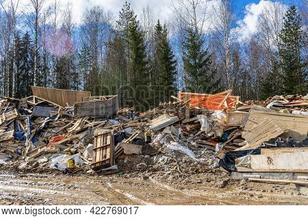 Illegal Dump In The Woods. Environmental Pollution From Construction Waste. Negative Impact On Natur