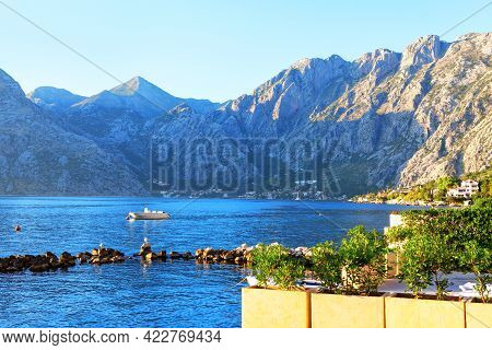 Coastal Terrace With Harbor . Coastal Getaways Surrounded By Mountains