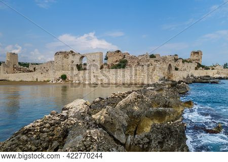 Remains Of Stone Dam, That Protected Bay Of City Kizkalesi, Turkey. Ancient Fortress Corycus Is On B