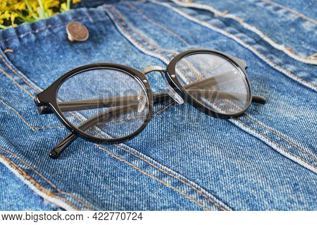 Wildflowers And Eye Glasses With Black Rims On The Pocket Of A Blue Denim Jacket, Trend Eye Glasses,