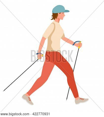 Girl Doing Nordic Walk Outdoors. Young Woman Hiking With Walking Poles Exersising Nordic Walking. He