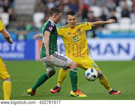 Lyon, France - June 16, 2016: Corry Evans Of Northern Ireland (l) Fights For A Ball With Yevhen Kono