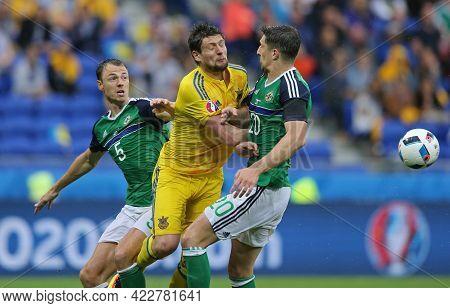 Lyon, France - June 16, 2016: Yevhen Seleznyov Of Ukraine (c) Fights For A Ball With Jonny Evans (l)