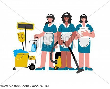 Female Hotel Maids In Uniform With A Vacuum Cleaner, Pushing Trolley Cart, Clean Linens For The Room