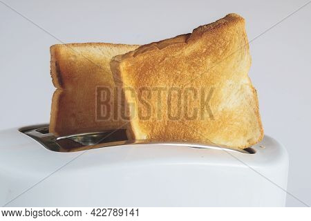 Couple Of Crusty Toast In The Toaster, Close Focus.