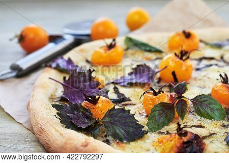 Pizza With Yellow Cherry Tomatoes, Cheese And Basil.