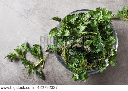 Fresh Nettle In A Glass Bowl For Making Stinging Nettle Soup, Top View.