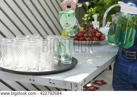 Summer Refreshing Drink In A Transparent Jug. Preparing Drink For Garden Party.
