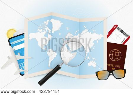 Travel Destination Somalia, Tourism Mockup With Travel Equipment And World Map With Magnifying Glass