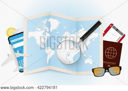 Travel Destination Uganda, Tourism Mockup With Travel Equipment And World Map With Magnifying Glass