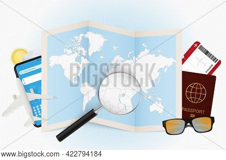 Travel Destination Rwanda, Tourism Mockup With Travel Equipment And World Map With Magnifying Glass