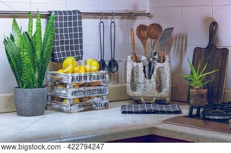 Beautiful Modern Kitchen Interior. Stylish Design Solution. Kitchen Tools. Large Box with Fresh Ripe Lemons. Tasty Healthy Nutrition.