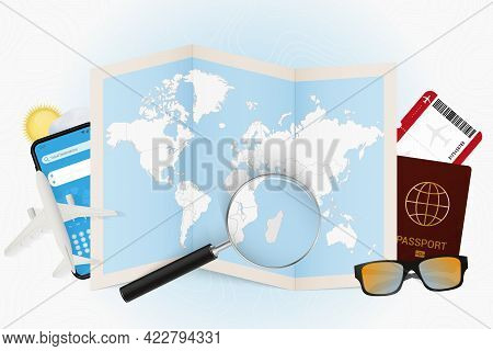 Travel Destination Madagascar, Tourism Mockup With Travel Equipment And World Map With Magnifying Gl