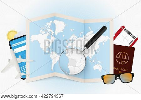 Travel Destination Angola, Tourism Mockup With Travel Equipment And World Map With Magnifying Glass