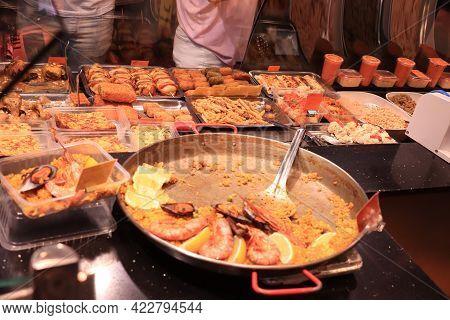 Barcelona, Spain - September 30th 2019: Fresh Made Paella At Boqueria Market, The Biggest Fresh Mark