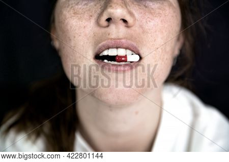 Young Woman,teenager With Capsule On Tong On Dark Black Background, Taking Pills. Medicine,drugs,hea