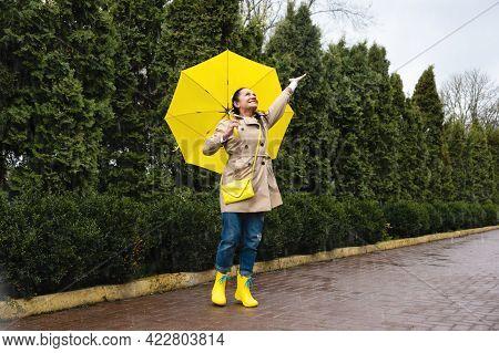 Happy Senior Woman, Cheerful Mature, Elderly, Retired Woman With Yellow Umbrella Enjoying Life At Ra