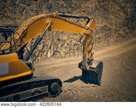 Crawler Excavator Bucket Digging A Pit On Construction Site