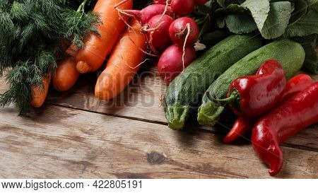 Paprika, Zucchini, Radish, Carrots And Bunch Of Dill Lie On Weathered Wooden Table. Ripe Vegetables