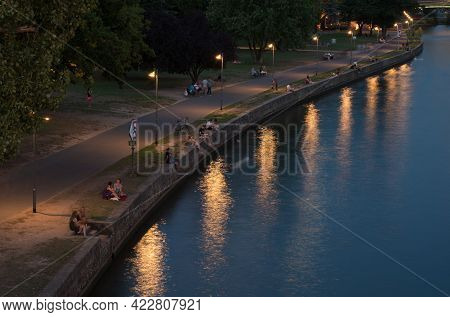 Frankfurt, Germany, August 31 2015: Group Of People Relaxing And Chatting Along The River Bank Frank