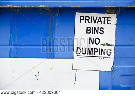 Private Bins No Dumping Sign On Blue Skip