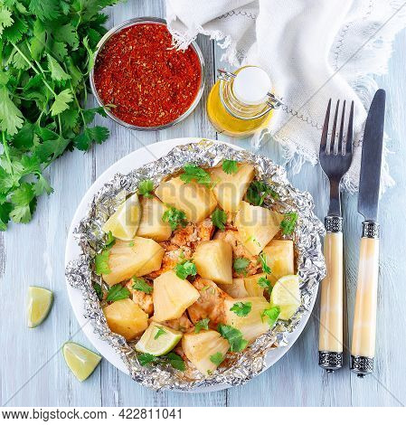 Cajun Pineapple Chicken, Baked In A Foil Packet, Garnished With Lime And Cilantro, Top View, Square