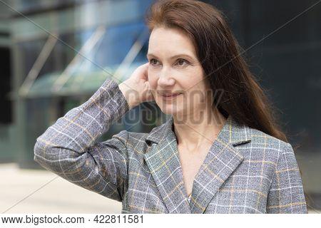 Closeup Portrait Of Happy Adult Woman. Mature Middle Age Businesswoman Smiling Near Business Centre.