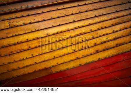 The Wooden Hull Of A Small Boat For Use As A Background Or Texture. An Abstract Of The Freeboard And