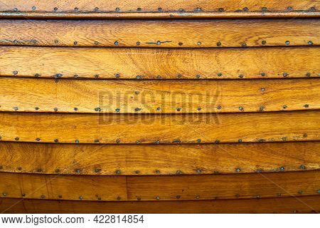 The Wooden Hull Of A Small Boat. Wooden Panels And Plans Of A Small Handmade Boat.