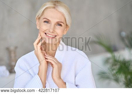 Headshot Of Happy Smiling Beautiful Middle Aged Woman Wearing Bathrobe At Spa Salon Hotel Looking At
