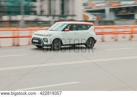 Moscow, Russia - May 2021: Side View Of Kia Soul Car In Motion. White Compact Hatchback Moving On Th