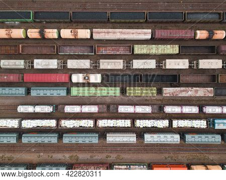 Cargo Trains Close-up. Aerial View Of Colorful Freight Trains On The Railway Station. Wagons With Go