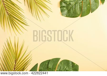 Summer Concept. Flat Lay, Top View, Copy Space . Tropical Palm Leaves On Yellow Background.