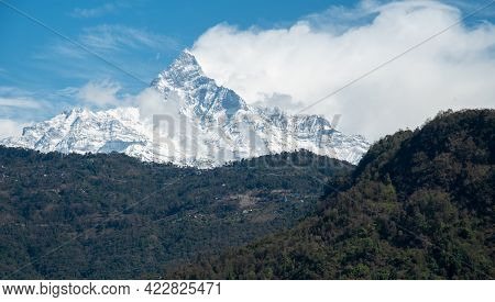 Annapurna Massif Mountains In The Himalayas Covered In Clouds, Snow And Ice In North Central Nepal A