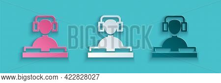 Paper Cut Dj Wearing Headphones In Front Of Record Decks Icon Isolated On Blue Background. Dj Playin