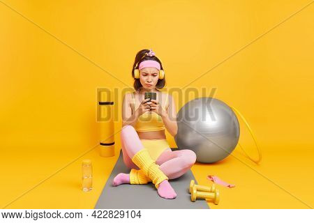 Sport Healthy Lifestyle And Motivation Concept. Serious Displeased Young Asian Woman Focused At Smar