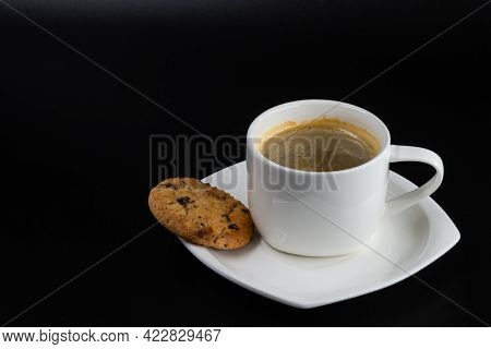 White Coffee Mug With Biscuit And Coffee On A Black Background
