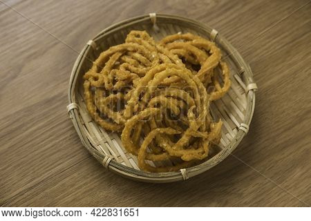 Murukku Is A Savory, Crunchy Snack Originating From The Indian Subcontinent.its An Indian Traditiona