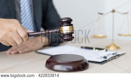Lawyer or judge holding Hammer prepares to judge the case with justice, Legal consulting services an
