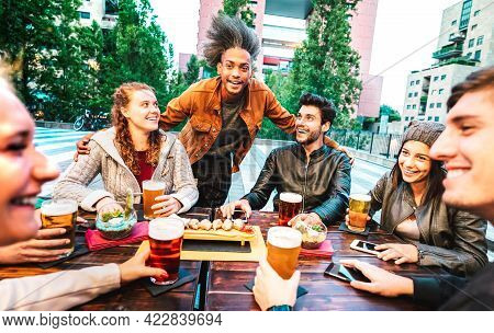 Young People Drinking Beer At Brewery Bar Dehor - Friendship Lifestyle Concept With Multicultural Fr