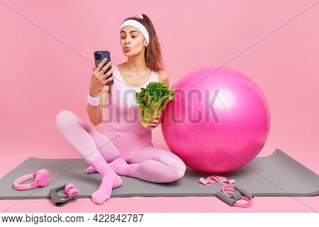Sporty Lovely Healthy Woman Keeps Lips Rounded Makes Selfie Poses With Fresh Vegetable Poses On Fitn