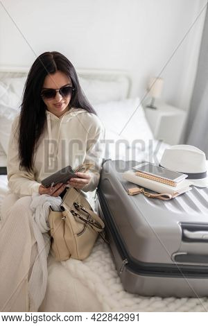 Trendy Woman Counting Checking Money Cash Dollar In Wallet Before Leaving Bedroom Ready To Travel