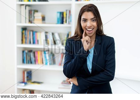 Happy Mexican Female Business Trainee At Office Of Company